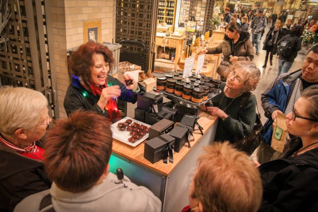 COURTESY SHANE FALLON San Francisco's Gourmet Walks food and chocolate walking tours hosts visits to chocolate havens around the city. Here, tour guests sample Recchiuti chocolates at the Ferry Building.