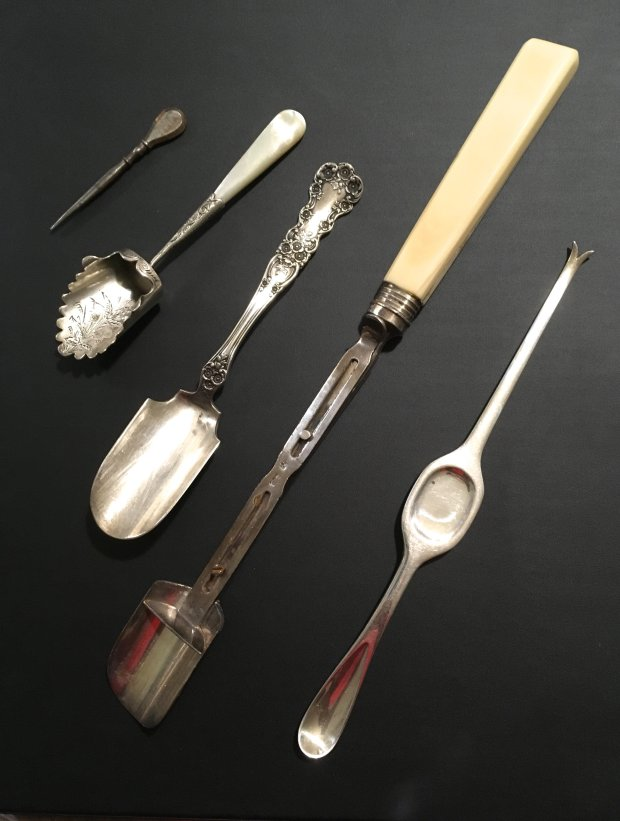 Each of these antique silver scoops or serving pieces had a different purpose. (Photo courtesy of Jane Alexiadis)