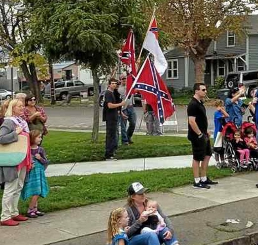 A photo posted on Rep. Jared Huffman's Facebook page shows men holding Confederate flags during the Veteran's Day parade Friday in Petaluma. (Jared Huffman via Facebook.com) A photo posted on Rep. Jared Huffman's Facebook page shows men holding Confederate flags during the Veteran's Day parade Friday in Petaluma. (Jared Huffman via Facebook.com)