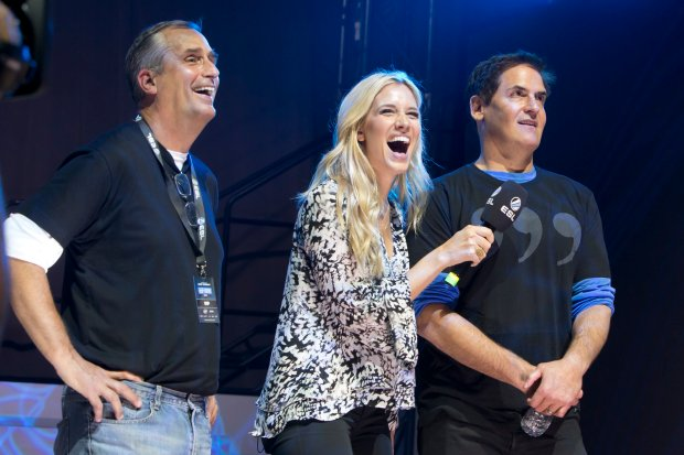 "Field reporter Kristine Leahy, center, speaks to billionaire Dallas Marvericks owner Mark Cuban and Intel CEO Brian Krzanich during a ""League of Legends"" charity match at the 2015 IEM San Jose."