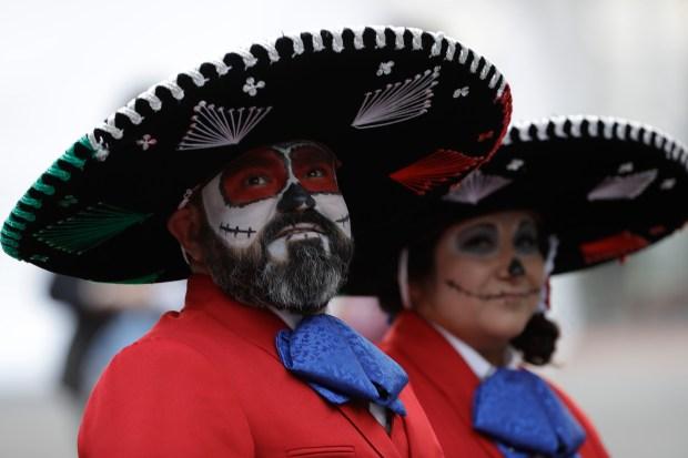 Houston Texans fans arrive to Azteca Stadium before an NFL football game against the Oakland Raiders Monday, Nov. 21, 2016, in Mexico City. (AP Photo/Eduardo Verdugo)