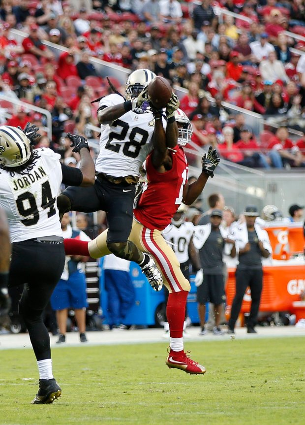 New Orleans Saints' B.W. Webb (28) interception catch against the San Francisco 49ers' Aaron Burbridge (13) in the second half of their NFL game at Levi's Stadium in Santa Clara, Calif., on Sunday, Nov. 6, 2016. (Josie Lepe/Bay Area News Group)