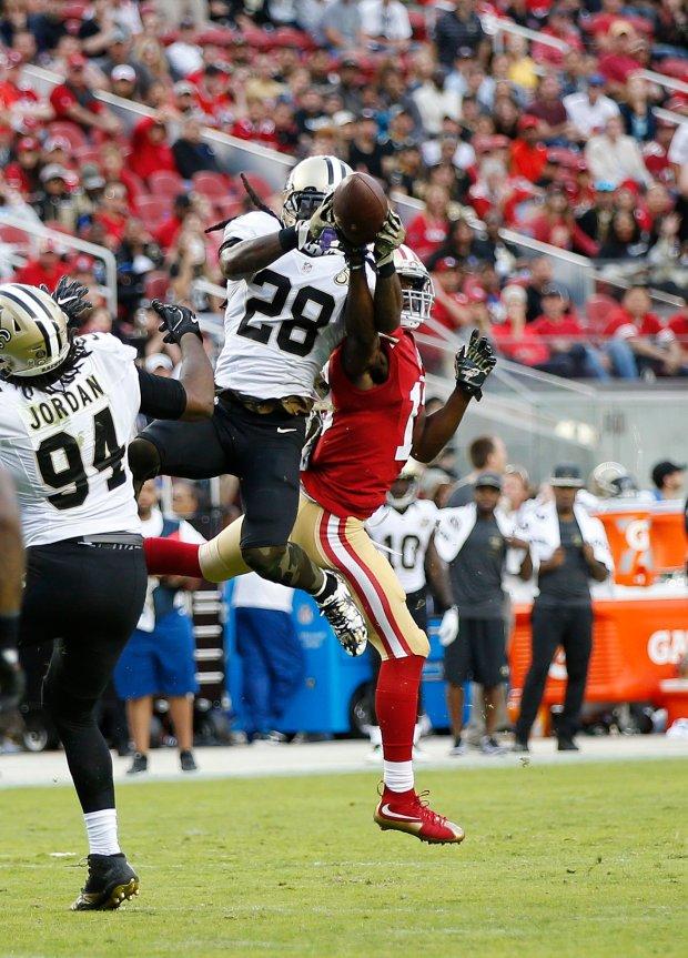 New Orleans Saints' B.W. Webb (28) interception catch against the San Francisco 49ers' Aaron Burbridge (13) in the second half of their NFL game at Levi's Stadium in Santa Clara, Calif., on Sunday, Nov. 6, 2016. (Josie Lepe/Bay Area News Group)