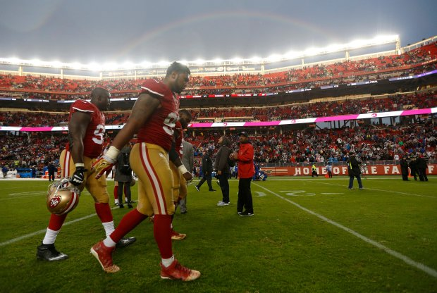 San Francisco 49ers' DeForest Buckner (99) walks off the field with San Francisco 49ers' Tank Carradine (95) following their 30-17 loss to the New England Patriots for their NFL game at Levi's Stadium in Santa Clara, Calif., on Sunday, Nov. 20, 2016. (Nhat V. Meyer/Bay Area News Group)
