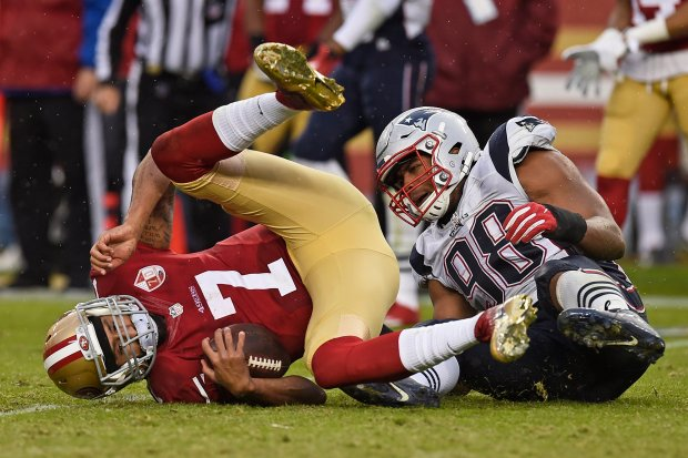 San Francisco 49ers quarterback Colin Kaepernick (7) is sacked by New England Patriots' Trey Flowers (98) in the fourth quarter of their NFL game at Levi's Stadium in Santa Clara, Calif., on Sunday, Nov. 20, 2016. New England defeated San Francisco 30-17. (Jose Carlos Fajardo/Bay Area News Group)