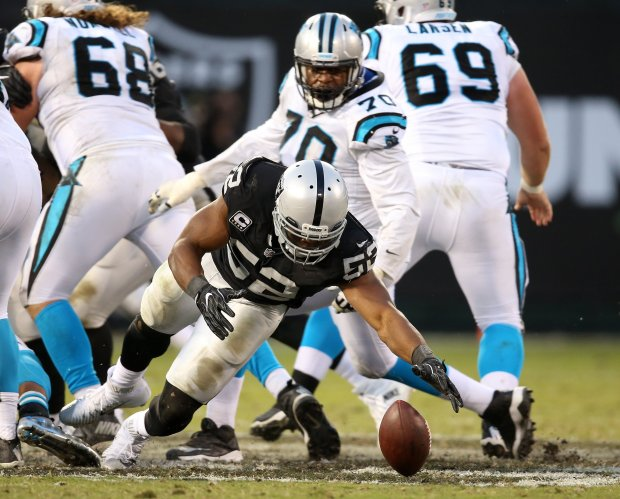 Oakland Raiders defensive end Khalil Mack (52) recovers a fumble from Carolina Panthers quarterback Cam Newton during the fourth quarter of their game on Sunday, Nov. 27, 2016, in Oakland, Calif. The Raiders beat the Panthers 35-32. (Aric Crabb/Bay Area News Group)