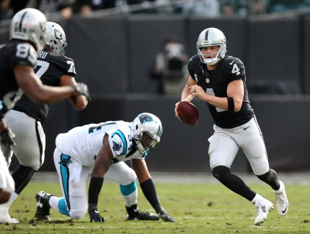 Oakland Raiders quarterback Derek Carr (4) scrambles up the field during the first quarter of their game against the Carolina Panthers on Sunday, Nov. 27, 2016, in Oakland, Calif.  (Aric Crabb/Bay Area News Group)