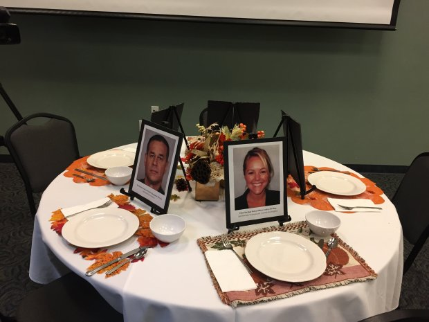 A mock Thanksgiving table is adorned by police officers fatally shot in recent weeks across the country as part of news conference by the San Jose Police Officers' Association on Nov. 23, 2016.
