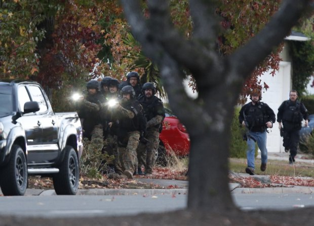 Aan Jose police prepare to enter a home near 4400 Camden Ave in San Jose, Calif., on Monday, Nov. 9, 2015. (Nhat V. Meyer/Bay Area News Group)