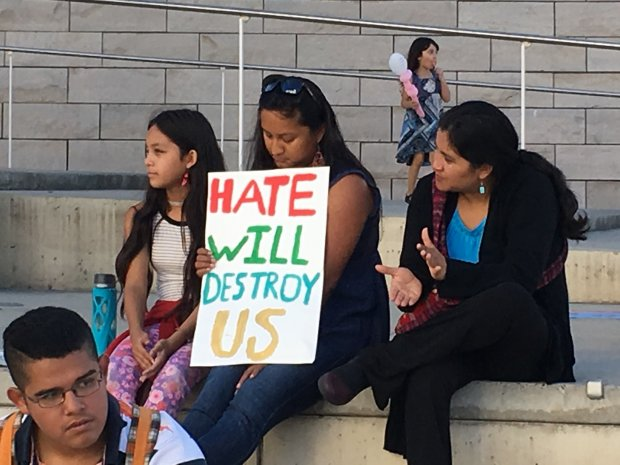 Rosa De Leon, center, and her sister Flor De Leon, right, listen to speakers at a rally at San Jose City Hall Saturday, Nov. 12, 2016, protesting the election of Donald Trump. (Sharon Noguchi/Bay Area News Group)