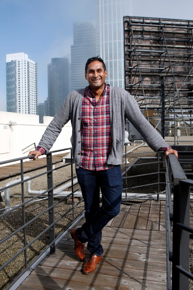Vijay Karunamurthy, the CEO and co-founder of Nom, a social network where foodies post live videos and photos, poses on the roof of the Clock Tower Building that house the company offices in San Francisco, Calif., Monday, Nov. 14, 2016. Karunamurthy, a former engineering manager at YouTube and Google, started the app with YouTube co-founder Steve Chen. (Karl Mondon/Bay Area News Group)