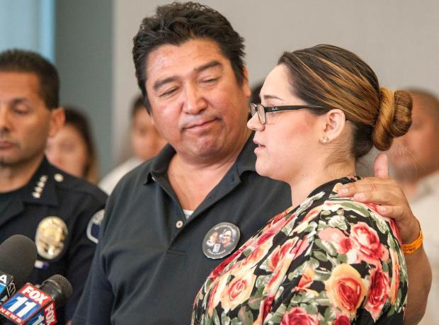 Ralph Chavez listens to his daughter Rachel  describe the best of her brother Chris. (KEN STEINHARDT, THE ORANGE COUNTY REGISTER)