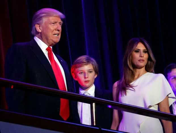 FILE - In this Nov. 9, 2016, file photo, President-elect Donald Trump, left, arrives to speak at an election night rally with his son Barron and wife Melania, in New York. Breaking with tradition, Donald Trump will move into the White House after the inauguration while wife Melania and 10-year-old son Barron plan to remain in New York City until at least the end of the school year. (AP Photo/Evan Vucci, File)