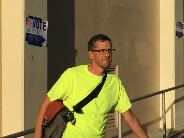 Steven Saum, 48, stands outside his polling place at Lincoln High School. (Mark Gomez, Staff)