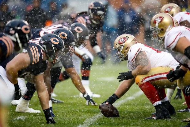 CHICAGO, IL - DECEMBER 04: Daniel Kilgore #67 of the San Francisco 49ers prepares to snap the football in the first quarter against the Chicago Bears at Soldier Field on December 4, 2016 in Chicago, Illinois. (Photo by Joe Robbins/Getty Images)