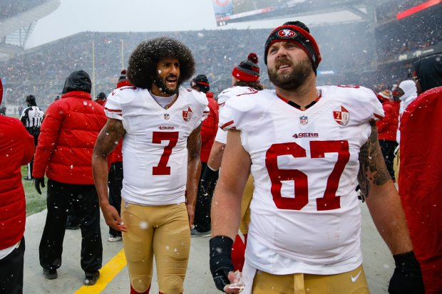 CHICAGO, IL - DECEMBER 04: Quarterback Colin Kaepernick #7 of the San Francisco 49ers and Daniel Kilgore #67 stand on the sidelines in the first quarter against the Chicago Bears at Soldier Field on December 4, 2016 in Chicago, Illinois. (Photo by Joe Robbins/Getty Images)