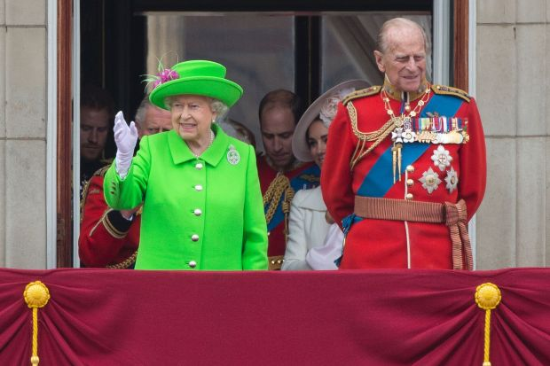 "(FILES) This file photo taken on June 11, 2016 shows (L-R) Britain's Queen Elizabeth II and Prince Philip, Duke of Edinburgh waving from the balcony of Buckingham Palace to watch a fly-past of aircrafts by the Royal Air Force, in London on June 11, 2016 during the annual Queen's 90th birthday celebration. Queen Elizabeth II has cancelled her departure on December 21, 2016 for a Christmas trip to her country estate because she and her husband have ""heavy colds"", a Buckingham Palace spokesman said. The 90-year-old monarch and her 95-year-old husband Prince Philip had been expected to travel from London as part of a yearly tradition. / AFP PHOTO / JUSTIN TALLISJUSTIN TALLIS/AFP/Getty Images"
