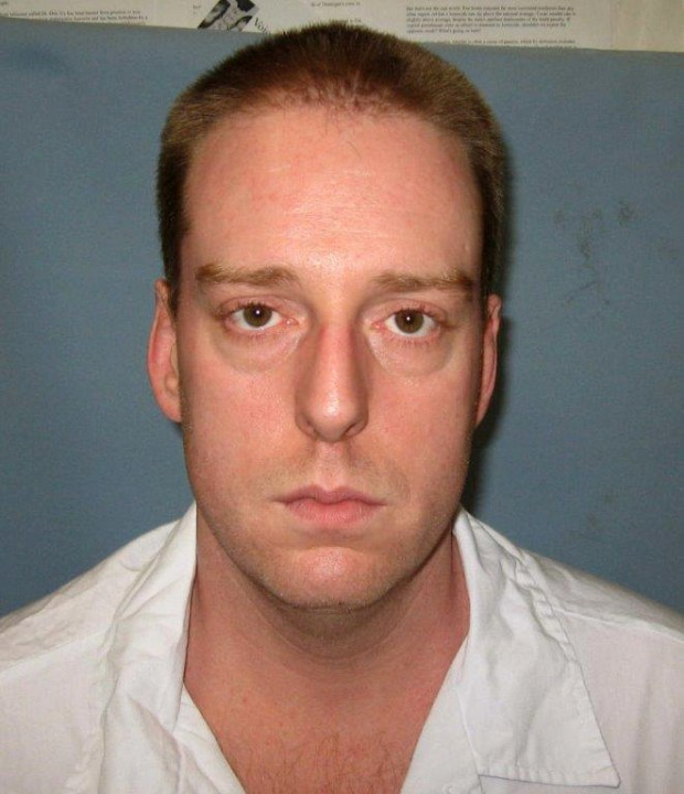 FILE - This undated photo provided by the Alabama Department of Corrections shows Ronald Bert Smith Jr.. Smith, who is scheduled to be executed Thursday, Dec. 8, 2016 for the 1994 slaying of Huntsville store clerk Casey Wilson, is asking the governor to stop his execution because a judge imposed a death sentence over the jury's 7-5 recommendation of life imprisonment. (Alabama Department of Corrections via AP, File)