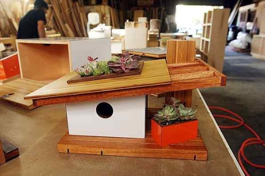 One of the more popular birdhouses looks like a 1950s-style home with succulent vegetation on the roof and porch. (Dan Coyro — Santa Cruz Sentinel)