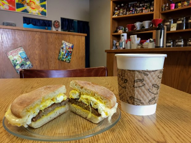 An English muffin breakfast sandwich with fried egg, sausage and Swisscheese at Pleasanton's Characterz Cafe and Coffee Roasterz. Photo credit: Mary Orlin/Bay Area News Group
