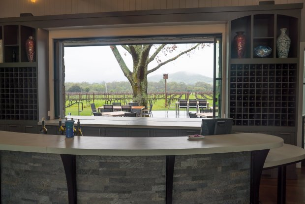 The view from inside the new Goosecross Cellars winery overlooking thepatio and estate vineyards in Oakville. Photo credit: Courtesy Jon Orlin