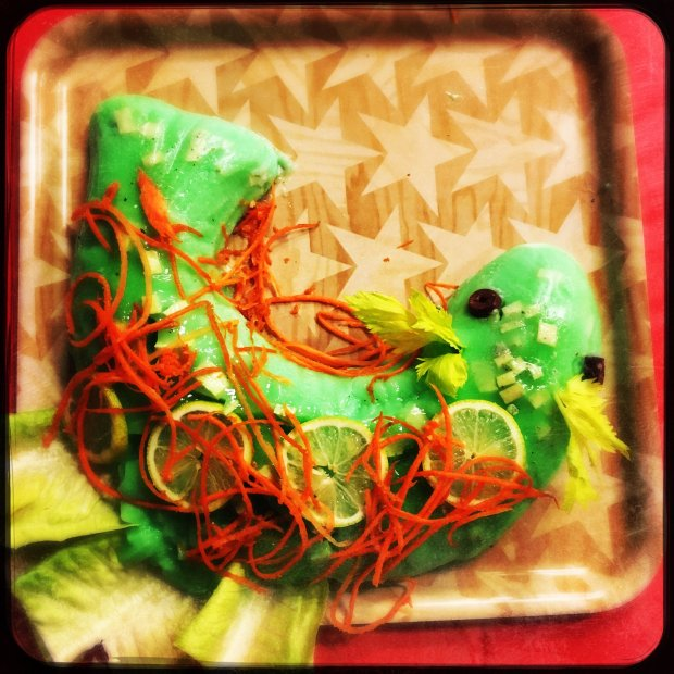 "This image was made using a smartphone with filters Histamatic. Best use of Aspic green ""Marge's Molded Salad"" by Jason Pontius at the annual Mid-Century Supper Club Potluck at the Alameda Fraternal Order of Eagles Hall in Alameda, Calif., on Saturday, December 10, 2016. Over 200 attended the ninth annual Mid-Century Supper Club Potluck hosted by Jennye Garibaldi and Karen Finlay."