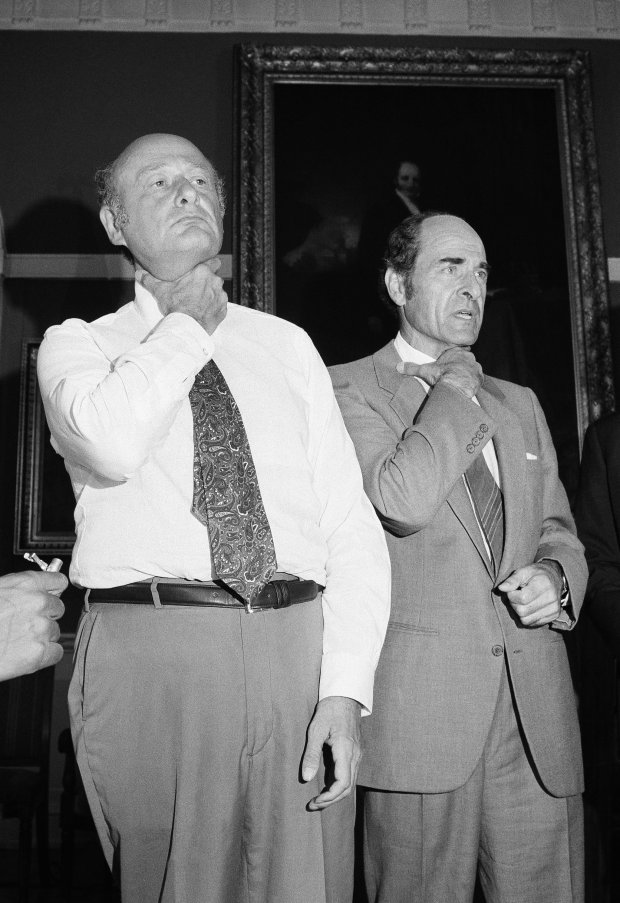 FILE - In this Aug. 7, 1981, file photo, Dr. Henry Heimlich, right, and Mayor Edward Koch demonstrate how a chocking victim should signal for help at New York's City Hall during Heimlich's discussion of his Heimlich Maneuver. Heimlich, the surgeon who created the life-saving Heimlich maneuver for choking victims has died Saturday, Dec. 17, 2016, at Christ Hospital in Cincinnati. He was 96. (AP Photo/Suzanne Vlamis, File)