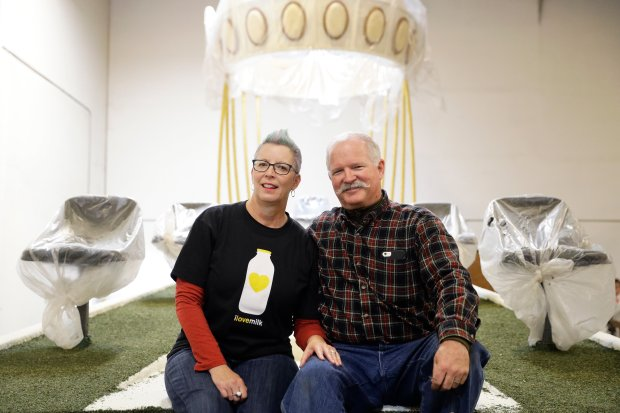 In this Wednesday, Dec. 28, 2016, photo, Christian Guntert, right, and his girlfriend Susan Brown pose for photos on a Rose Parade float they are getting married on in Irwindale, Calif. The couple of 17 years are getting married Saturday on the float. (AP Photo/Jae C. Hong)