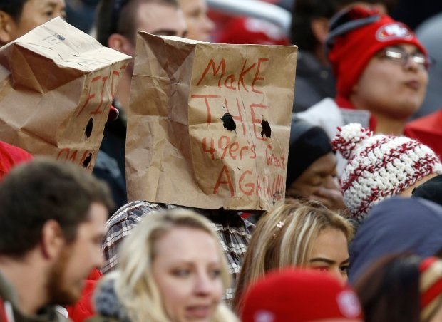 "A San Francisco 49ers fan wears a paper bag that reads ""Make THE 49ers Great AGAIN!!!!"" during the 49ers game against the New York Jets in the fourth quarter of their NFL game at Levi's Stadium in Santa Clara, Calif., on Sunday, Dec. 11, 2016. (Nhat V. Meyer/Bay Area News Group)"