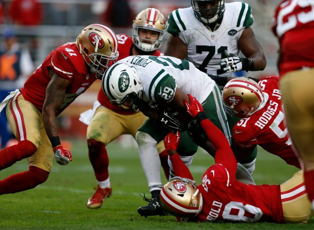 New York Jets' Bilal Powell (29) scores a touchdown against the San Francisco 49ers, including 49ers' Eli Harold (58) and 49ers' Antoine Bethea (41) in the fourth quarter of their NFL game at Levi's Stadium in Santa Clara, Calif., on Sunday, Dec. 11, 2016. (Nhat V. Meyer/Bay Area News Group)
