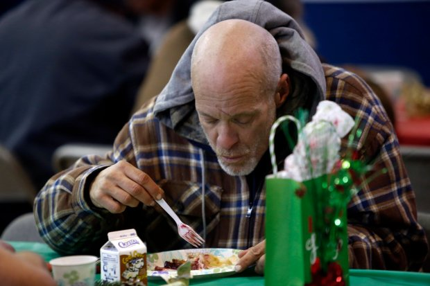 Mike Stone, homeless since 1999, eats a Christmas meal at St. Joseph's Family Center in Gilroy, Calif., Sunday, Dec. 25, 2016. Members of a Morgan Hill synagogue, Congregation of Emith, have made it an annual tradition to relieve church staff so that they may be with their families on Christmas Day. (Karl Mondon/Bay Area News Group)