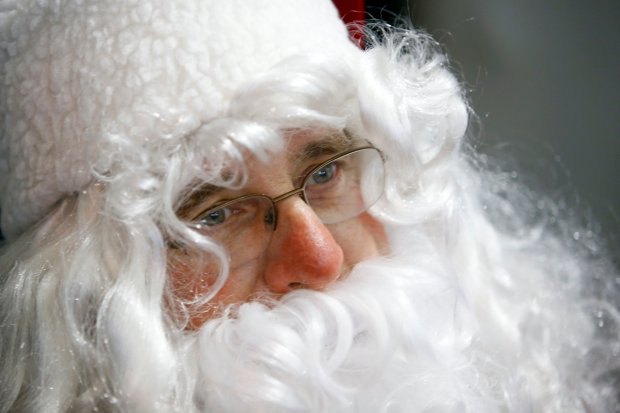 Michael Oshan, one of the founding members of the Congregation of Emeth's annual Christmas Day meal service, plays Santa Claus at St. Joseph's Family Center in Gilroy, Calif., Sunday, Dec. 25, 2016. The Morgan Hill synagogue has made it an annual tradition to relieve church staff so that they may be with their families on Christmas Day. (Karl Mondon/Bay Area News Group)