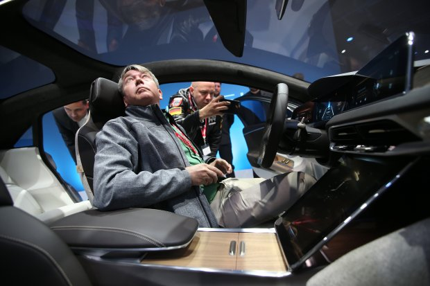 "Automotive journalist Jeff Nisewanger sits in the driver seat of the new ""air"" electric car by Lucid Motors Inc. on Wednesday, Dec. 14, 2016, in Fremont, Calif."