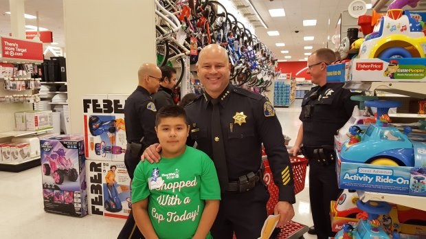 "San Jose Police Chief Eddie Garcia with Miguel R., one of the students whoparticipated in the ninth annual Shop With a Cop Silicon Valley ""Heroes and Helpers"" event on Thursday, Dec. 8, 2016. (Photo courtesy San Jose Police Department)"