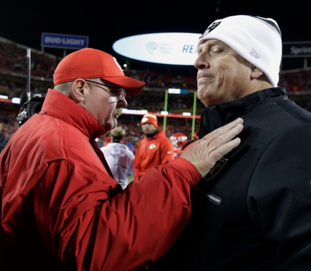 Kansas City Chiefs head coach Andy Reid, left, and Oakland Raiders head coach Jack Del Rio greet each other after an NFL football game Thursday, Dec. 8, 2016, in Kansas City, Mo. The Chiefs won 21-13. (AP Photo/Charlie Riedel)