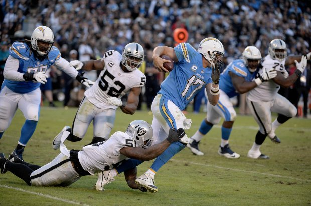 SAN DIEGO, CA - DECEMBER 18: Bruce Irvin #51 of the Oakland Raiders sacks Quarterback Philip Rivers #17 of the San Diego Chargers late in the fourth quarter en route to the Raiders 19-16 win over Chargers at Qualcomm Stadium on December 18, 2016 in San Diego, California. (Photo by Donald Miralle/Getty Images)