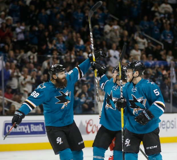San Jose Sharks defenseman Brent Burns (88) congratulates defenseman Paul Martin (7) on his goal with and assist by center Chris Tierney (50) in the first period at SAP Center Saturday, Dec. 10, 2016, in San Jose, Calif. (Jim Gensheimer/Bay Area News Group)