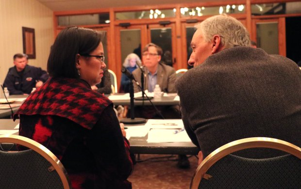 Menlo Park Fire Protection District Board Member Virginia Chang Kiraly, left, and Atherton Mayor Michael Lempres compare notes during a joint meeting of the district board and the city council in Holbrook-Palmer Park on Tuesday, Dec. 13, 2016. (John Orr / Daily News)