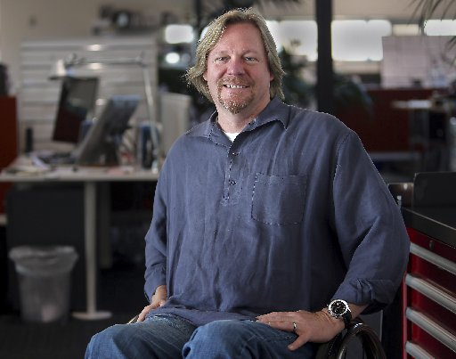 Darrin Caddes, vice president of Corporate Design at Plantronics, lost his ability to walk in a motorcycle accident in 2001. Earlier this month, a robotic exoskeleton helped him take his first steps since that accident. (Dan Coyro -- Santa Cruz Sentinel)