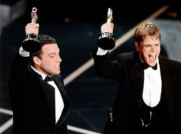 "Ben Affleck and Matt Damon, right, react to winning the Oscar for Best Original Screenplay for ""Good Will Hunting"" at the 70th Academy Awards in Los Angeles Monday, March 23, 1998. (AP Photo/Susan Sterner)"
