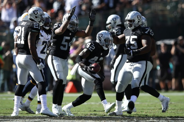 OAKLAND, CA - OCTOBER 09: Karl Joseph #42 of the Oakland Raiders celebrates after intercepting a pass by Philip Rivers #17 of the San Diego Chargers during their NFL game at Oakland-Alameda County Coliseum on October 9, 2016 in Oakland, California. (Photo by Ezra Shaw/Getty Images)