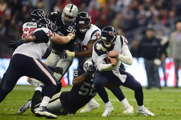 Oakland Riders Khalil Mack (52) tackles Houston Texans Brock Osweiler (17) during the 2016 NFL week 11 regular season football game on November 21, 2016 at the Azteca Stadium in Mexico City. / AFP / ALFREDO ESTRELLA (Photo credit should read ALFREDO ESTRELLA/AFP/Getty Images)