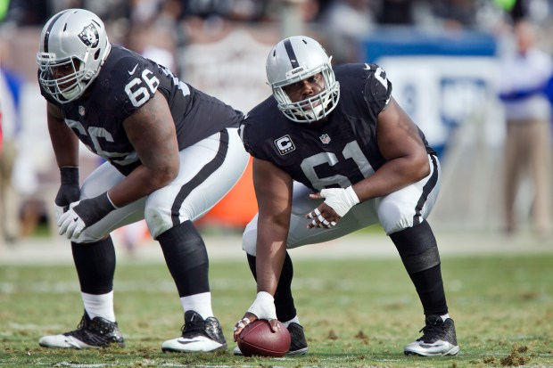 OAKLAND, CA - DECEMBER 4: Center Rodney Hudson #61 and guard Gabe Jackson #66 of the Oakland Raiders prepare to snap the ball in the second quarter on December 4, 2016 at Oakland-Alameda County Coliseum in Oakland, California. The Raiders won 38-24. (Photo by Brian Bahr/Getty Images)