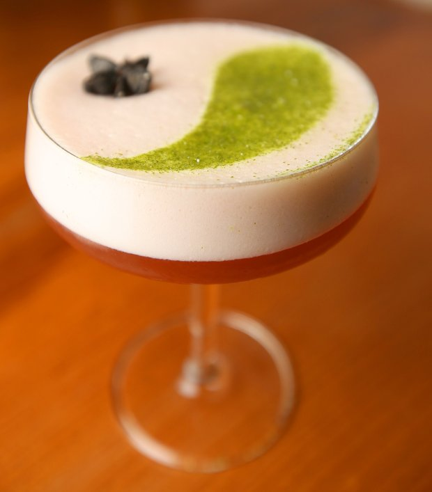 Honu cocktail is photographed at aina restaurant on Tuesday, Jan. 10, 2017, in San Francisco, Calif. The drink is made with Byrrh, Ferreira white port, lemon juice, black and white pepper syrup, egg white, anise hyssop, and dusted with lemon verbena sugar. (Aric Crabb/Bay Area News Group)