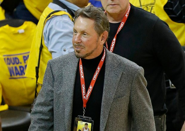 FILE - In this Thursday, May 1, 2014 file photo, Oracle CEO Larry Ellison arrives at an opening-round NBA basketball playoff series between the Golden State Warriors and the Los Angeles Clippers in Oakland, Calif. The eight individuals who own as much as half of the rest of the planet are all men, and have largely made their fortunes in technology. Ellison has recently focused more on cloud computing, in which data is stored and managed across a network of computers. His fortune comes from the 27 percent stake he still owns in Oracle, currently worth $160 billion. (AP Photo/Jeff Chiu, file)
