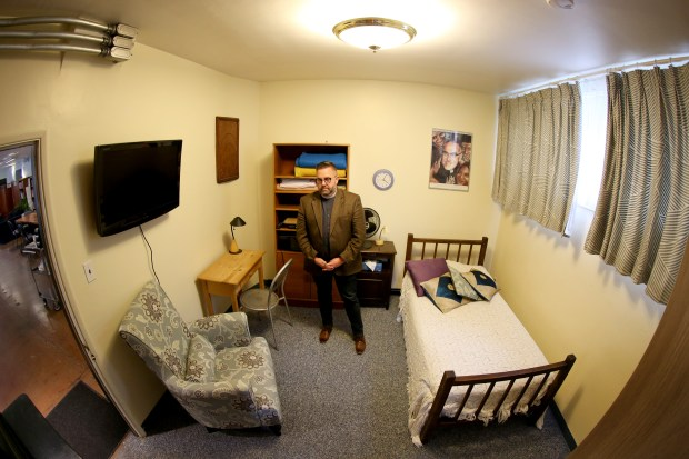 Rev. Jeff Johnson of the Universal Lutheran Chapel in Berkeley stands in a converted sanctuary apartment in the basement of the church in Berkeley, Calif., on Tuesday, Jan. 31, 2017. The small apartment that includes its complete bathroom, is designed for one person or a small family facing deportation proceedings. (Ray Chavez/Bay Area News Group)