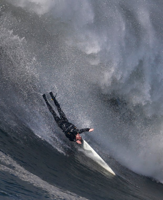 A surfer wipes out as big wave riders take advantage of the recent high surf to take on the giant waves at the Mavericks surf break near Half Moon Bay, Calif., Thursday, Jan. 26, 2017. The actual Mavericks Big Wave Surfing contest hasn't been called yet. (Patrick Tehan/Bay Area News Group)