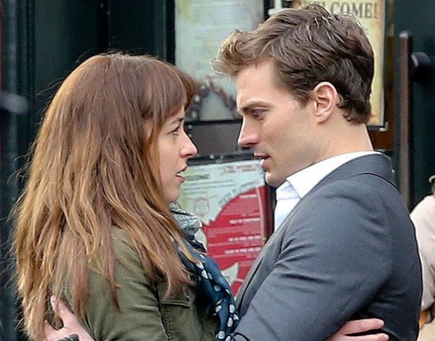 "Dakota Johnson and Jamie Dornan shoot a scene for the film ""Fifty Shades of Grey."" (Focus Features)"
