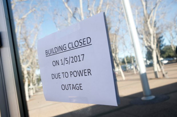A closed building notice is posted on a door after the Santa Clara County Government Center building at 70 West Hedding Street closed due to power failure Thursday, Jan. 5, 2017, in San Jose, Calif. (Jim Gensheimer/Bay Area News Group)