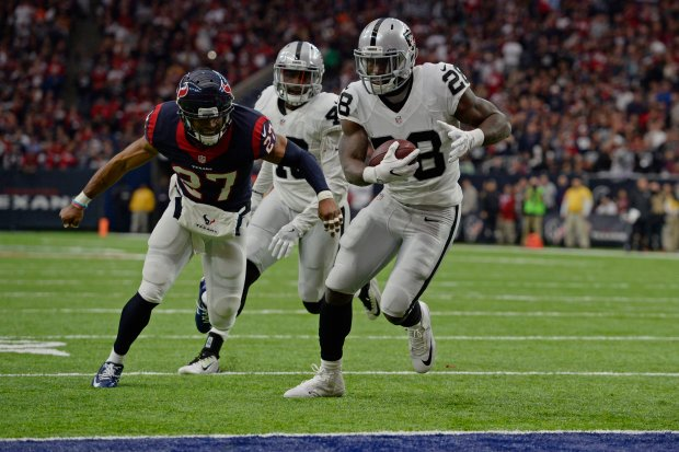 Oakland Raiders' Latavius Murray (28) runs in for a touchdown past Houston Texans' Quintin Demps (27) in the first quarter of the AFC West Wild Card round game at the NRG Stadium in Houston, Texas, on Saturday, Jan. 7, 2017. (Jose Carlos Fajardo/Bay Area News Group)